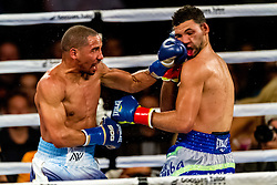 ONTARIO, California/USA (Saturday, Nov 16 2013) - WBA super middleweight champion Andre Ward (27-0, 14 KOs) (dark trunk w/white stripes) outclassed Edwin Rodriguez (blue trunks) by unanimous decision with scores of 118-106, 117-107, 116-108. Edwin suffered a pretty bad cut on his left eye. The U.S. Olympic gold medalist rose to prominence with a victory in the Super Six 168-pound tournament before beating Dawson to join the world's top pound-for-pound fighters. PHOTO © SILVEXPHOTO.COM.