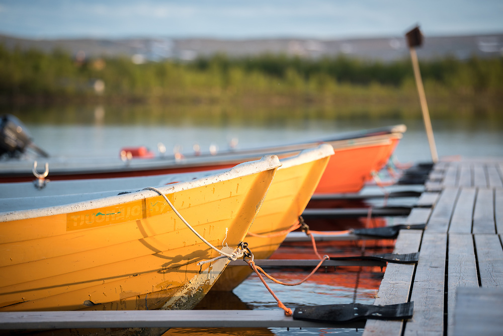 30 June 2017, Tjuonajokk, Lapland, Sweden: View of the dock area of the Tjuonajokk Fishing Lodge. Tjuonajokk is an old Sami village by the River Kaitum in northern Sweden, now used as a fishing lodge for flyfishers from across the world. The camp is part of Fishyourdream.