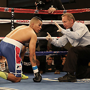 KISSIMMEE, FL - MARCH 06:  Fernando Martinez rests on the canvas after a punch by Anthony Way during the Telemundo Boxeo boxing match at the Kissimmee Civic Center on March 6, 2015 in Kissimmee, Florida. (Photo by Alex Menendez/Getty Images) *** Local Caption *** Fernando Martinez; Anthony Way