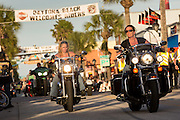 Women bikers ride down Main Street during the 74th Annual Daytona Bike Week March 8, 2015 in Daytona Beach, Florida. More than 500,000 bikers and spectators gather for the week long event, the largest motorcycle rally in America.