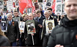 May 9, 2017 - Moscow, Russia - May 9, 2017. - Russia, Moscow. - Russian President Vladimir Putin with the portrait of his father Vladimir Spiridonovich Putin, a war veteran, and People's Artist of the Russian Federation Mikhail Nozhkin (right) taking part in the patriotic march, Immortal Regiment, which is devoted to the 72nd anniversary of the Victory in the Great Patriotic War of 1941-1945. (Credit Image: © Russian Look via ZUMA Wire)