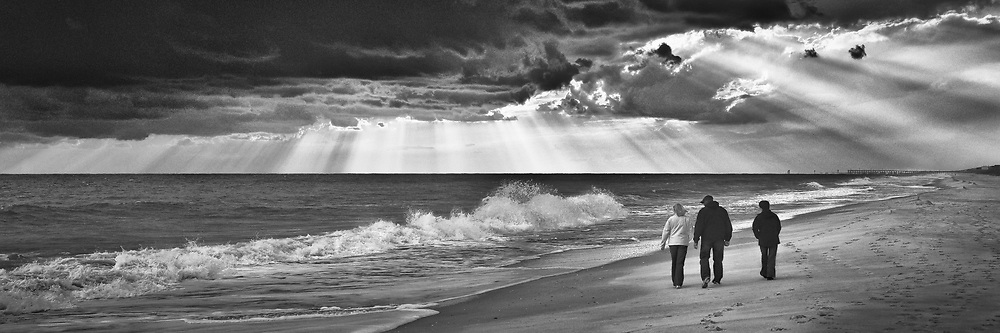 Stormy clouds come and go along this North Carolina beach. Aspect Ratio 1w x 0.333h