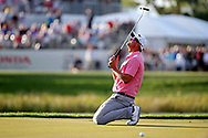 Feb 28, 2016; Palm Beach Gardens, FL, USA; Adam Scott reacts after missing a putt on the 17th hole during the final round of the Honda Classic at PGA National. Mandatory Credit: Peter Casey-USA TODAY Sports