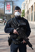 """March, 23rd 2020 - Paris, Ile-de-France, France: French CRS police wearing a range of masks and facial coverings in the hope of protecting themselves from the spread of the Coronavirus, during the eigth day of near total lockdown imposed in France. A week after President of France, Emmanuel Macron, said the citizens must stay at home from midday on Tuesday for at least 15 days. He said """"We are at war, a public health war, certainly but we are at war, against an invisible and elusive enemy"""". All journeys outside the home unless justified for essential professional or health reasons are outlawed. Anyone flouting the new regulations is fined. Nigel Dickinson"""