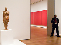 """Left to Right: """"Pregnant Woman"""" by Pablo Picasso; """"Vir Heroicus Sublimis"""" by Barnett Newman and a Guard; MoMa (Museum of Modern Art) New York, 2008."""