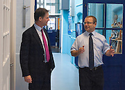 © Licensed to London News Pictures. 22/10/2014. London, UK. Nick Clegg talks with Headteacher John Grove.  Deputy Prime Minister Nick Clegg visits a school in London on Wednesday 22 October to address an audience of public sector workers - including teachers, social workers, local government and NHS staff, Civil Service apprentices & Fast Streamers. He gave a speech about the public sector as a whole and in it, thanked public sector workers for their hard work through challenging financial times. Photo credit : Stephen Simpson/LNP