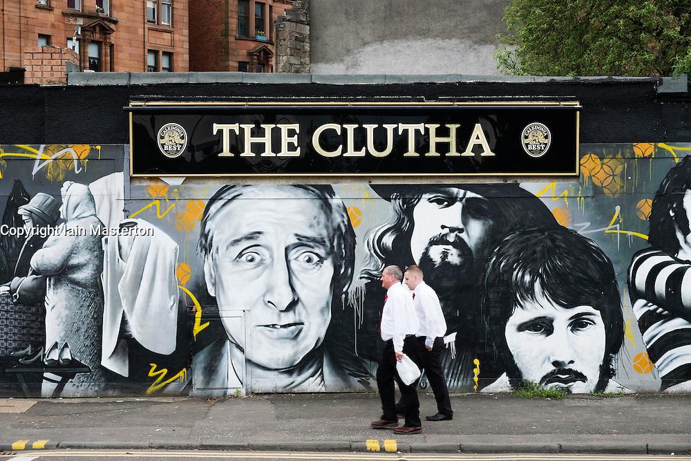 Men drinking outside Clutha pub in Glasgow united Kingdom
