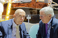 Garden City, New York, U.S.  November 14, 2019. L-R, NASA Apollo 10 Commander Lt. Gen. THOMAS STAFFORD, 89, talks with GENE LESSERSON, of Melville, in the LEM Room during the 17th Annual Cradle of Aviation Museum Air and Space Gala. Astronaut Tom Stafford received Spirit of Discovery Award. Lesserson is a volunteer photographer and docent for the museum in Long Island.