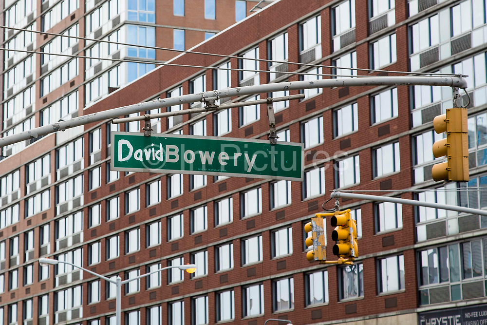 A green Bowery New York Street Sign has been decorated with the word David in tribute to the rock star David Bowie who died in January 2016 in Lower East Side, New York City, New York, Unites States of America.