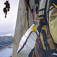 BAFFIN ISLAND, Canada, Gordon Wiltsie photographs from cantilevered poles, high on Great Sail Peak.