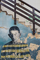 The stairs to the post office in Ushuaia. The wall are painted with prisoners as a memory to some of thos first inhabitants of Uschuaia who where convicts. Fin del Mundo, Patagonia, Argentina