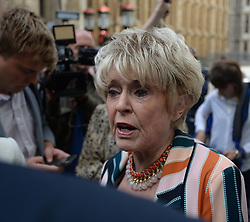 Television presenter Gloria Hunniford speaks outside the Rolls Building in London, where Sir Cliff Richard was awarded more than £200,000 in damages after winning his High Court privacy battle against the BBC over its coverage of a police search of his home in Sunningdale, Berkshire, in August 2014, following a child sex assault allegation.