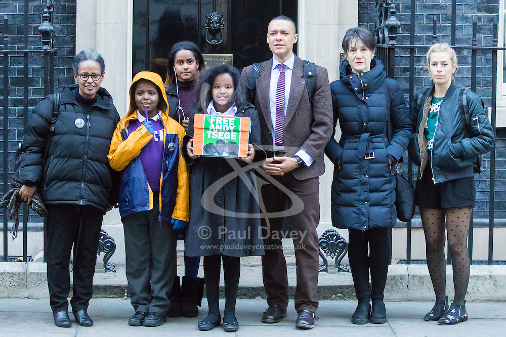 Downing Street, London, November 29th 2016. Family and supporters of democracy activist Andy Tsege, a British national and father of three, who has been held illegally in Ethiopia without charge since 2014 after being abducted, contrary to international law, from an airport in Yemen, deliver a petition to Downing Street asking Foreign Secretary Boris Johnson to intervene. Tsege is facing a death sentence, imposed in absentia in 2009. They were accompanied by  Clive Lewis MP, Shadow Secretary of State for Business, Energy and Industrial Strategy. PICTURED left to right: Yemi Haile Miriam, Yilak Andargachin, Helawit Haile Mariam, Menabe Andargachen, Clive Lewis MP, actress Dame Harriette Walter, comedienne Sara Pascoe.