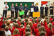 STEM club members make a presentation at the Okehampton Primary School assemby - one of the 11 feeder Primary schools the College has worked with to introduce sustainable energy. The school has just had PV solar panels installed and the theme will be 'not to waste the energy they are now making for themselves'.Okenhampton College, Devon.