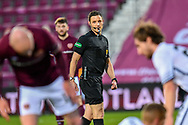 Referee Steven McLean watches the players during the SPFL Championship match between Heart of Midlothian FC and Alloa Athletic FC at Tynecastle Park, Edinburgh, Scotland on 9 April 2021.