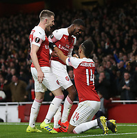 Arsenal's Ainsley Maitland-Niles celebrates scoring his side's second goal with Pierre-Emerick Aubameyang and Aaron Ramsey<br /> <br /> Photographer Rob Newell/CameraSport<br /> <br /> Football - UEFA Europa League Round of 16 Leg 2 - Arsenal v Rennes - Thursday 14th March 2019 - The Emirates - London<br />  <br /> World Copyright © 2018 CameraSport. All rights reserved. 43 Linden Ave. Countesthorpe. Leicester. England. LE8 5PG - Tel: +44 (0) 116 277 4147 - admin@camerasport.com - www.camerasport.com