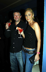 Singer JENNY FROST and her fiance DOM THRUPP at a party to celebrate the launch of Michelle Watches held at the Blue Bar, The Berkeley Hotel, London on 7th October 2004.<br /><br />NON EXCLUSIVE - WORLD RIGHTS