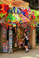 Chinese Kite Shop in Macau - The kite was first invented 2,800 years ago in China, where materials ideal for kite building were readily available: silk fabric for sail material, fine, high tensile strength silk for line and resilient bamboo for a strong, lightweight framework.