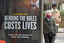 © Licensed to London News Pictures 19/02/2021.        Sidcup, UK. Covid-19 government advertising at a bus stop.  People out and about in Sidcup, South East London during a third coronavirus lockdown. Photo credit:Grant Falvey/LNP
