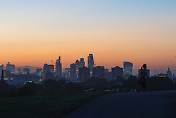 Primrose Hill, London, October 4th 2016. Dawn breaks across London, throwing the city's skyline into silhouette.