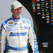 NASCAR Sprint Cup driver Michael Waltrip (55) is seen in the garage area during the NASCAR Coke Zero 400 Sprint practice session at the Daytona International Speedway on Thursday, July 4, 2013 in Daytona Beach, Florida.  (AP Photo/Alex Menendez)
