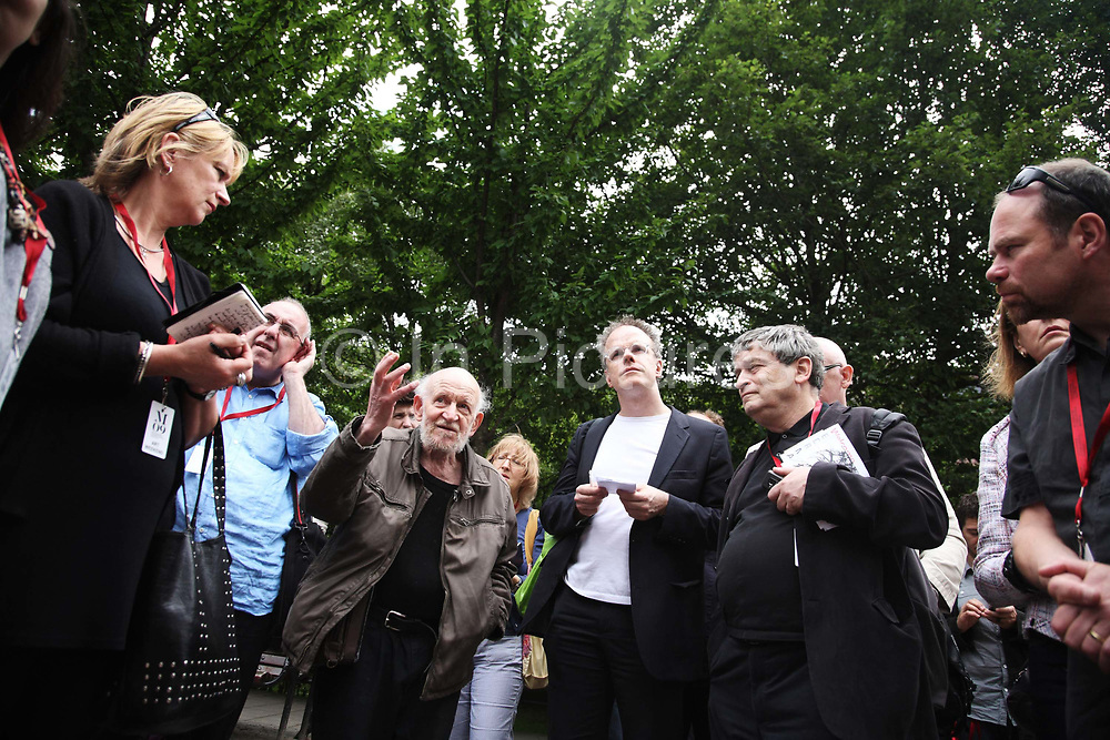 Gustav Metzger talks about Flailing Trees Manchester Art Festival with Hans Ulrich Obrist and a gathering of listeners at the opening of Flailing Trees, July 2007, in Manchester, United Kingdom. <br /> <br /> Flailing Trees is a piece of art by Gustav Metzger where 21 willow trees has been up-rooted and put upside down into concrete, symbolising a world turned upside down by global warming.