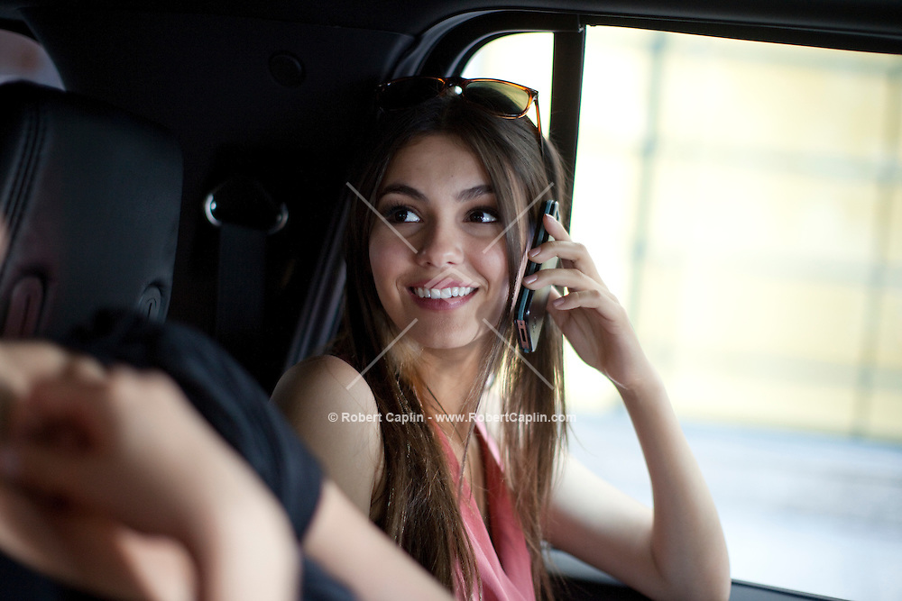 Actress and singer Victoria Justice on a phone interview in New York during Fall Fashion week 2011. ..Photo by Robert Caplin.