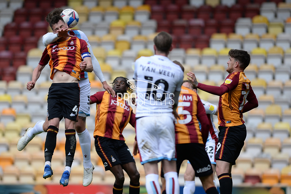 Scunthorpe United George Taft (3) heads the ball during the EFL Sky Bet League 2 match between Bradford City and Scunthorpe United at the Utilita Energy Stadium, Bradford, England on 1 May 2021.