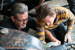 Cycle Zombies' Big Scott and Chase Stopnik works in Scotty's garage. Huntington Beach, CA. USA. June 29, 2015.  Photography ©2015 Michael Lichter.