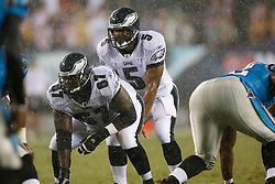 8 August 2008: Philadelphia Eagles quarterback Donovan McNabb #5  and offensive lineman Jamaal Jackson #67 prepare for a play in the pouring rain during the game against the Carolina Panthers on August 14, 2008. The Eagles beat the Panthers 24 to 13 at Lincoln Financial Field in Phialdelphia, Pennsylvania. (Photo by Brian Garfinkel)