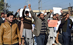 December 18, 2018 - Pakistan - PESHAWAR, PAKISTAN, DEC 17: Members of Khyber Union of Journalists are holding .protest demonstration for acceptance of their demands, at Peshawar press club on Monday, .December 17, 2018. (Credit Image: © PPI via ZUMA Wire)