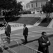 Secret Service Agents keep watch before President George W. Bush leaves the future site of the U.S. Institute of Peace in the Foggy Bottom neighbourhood in Washington D.C., USA.<br /> <br /> (Credit Image: © Louie Palu/ZUMA Press)