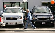 Jay Johnson Castro walks past the Clark Chevrolet dealership in McAllen on his way to Brownsville.