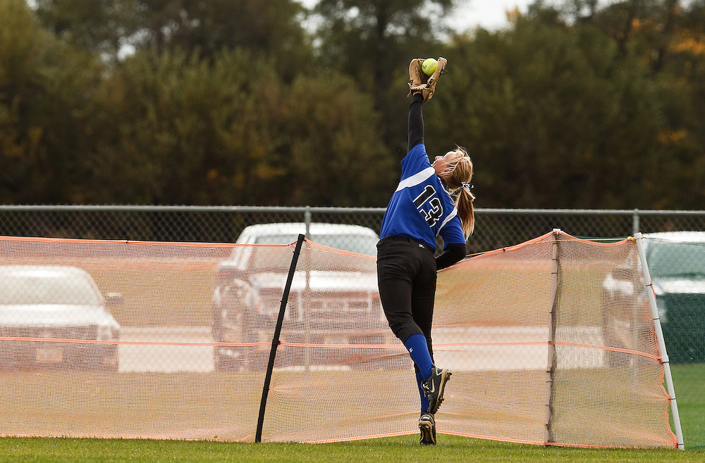 Lincoln East's Katherine Neal makes a catch at the fence robbing Grand Island's Jessica Kleine of a home run and ending Senior High's scoring streak in the seventh inning of Friday's District A-3 game at Veteran's Field Softball Complex in Grand Island. Senior High won 10-6. (Independent/Matt Dixon)