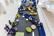Students and visitors rest in the commons area at the Duke Kunshan University in Kunshan, Jiangsu Province , China on 07 December, 2014.