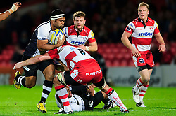 Fiji Hooker (#2) Tuapati Talemaitoga is tackled by Gloucester Number 8 (#8) Peter Buxton (capt) during the first half of the match - Photo mandatory by-line: Rogan Thomson/JMP - Tel: Mobile: 07966 386802 13/11/2012 - SPORT - RUGBY - Kingsholm Stadium - Gloucester. Gloucester Rugby v Fiji - International Friendly