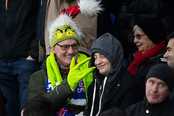 Crystal Palace fans in the stands wearing a Grinch hat