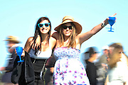 27 March 2010 : Fans cross the race track between races at the Carolina Cup.