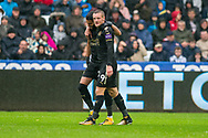 Riyad Mahrez (l) and Jamie Vardy of Leicester City celebrate after their 1st goal, a Mahrez shot deflected in off Fernando Fernandez of Swansea. Premier league match, Swansea city v Leicester city at the Liberty Stadium in Swansea, South Wales on Saturday 21st October 2017.<br /> pic by Aled Llywelyn, Andrew Orchard sports photography.