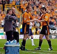 Photo. Jed Wee, Digitalsport<br /> NORWAY ONLY<br /> <br /> Wolverhampton Wanderers v Tottenham Hotspurs, FA Barclaycard Premiership, 15/05/2004.<br /> Wolves's Dennis Irwin (R) calls time on a glittering career as he leaves the pitch to a standing ovation for the last time, replaced by Jody Craddock in injury time.