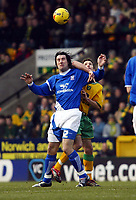 Photo: Chris Ratcliffe.<br /> Norwich City v Ipswich Town. Coca Cola Championship. 05/02/2006.<br /> Alan Lee of Ipswich tussles with Adam Drury of Norwich