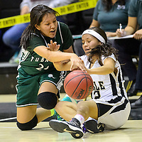 012414  Adron Gardner/Independent<br /> <br /> Tuba City Warrior Tate Tsingine (25), left, and Chinle Wildcat Brittany Yazzie (12) battle for possession in Chinle Friday.