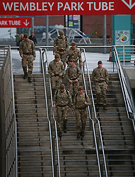 © Licensed to London News Pictures. 18/11/2015. London, UK Soldiers are seen outside Wembley Stadium ahead of the England v France football match. Photo credit: Peter Macdiarmid/LNP