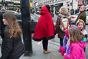 Like Little Red Riding Hood, an interesting take on the winter coat / cape in London, England, United Kingdom.