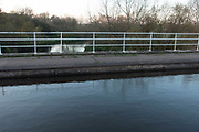 View along the Trent and Mersey Canal as it crosses via an aqueduct over the River Trent at Rugeley, Staffordshire, United Kingdom.