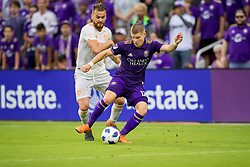 May 13, 2018 - Orlando, FL, U.S. - ORLANDO, FL - MAY 13: Orlando City forward Chris Mueller (17) with the ball during the soccer match between the Orlando City Lions and Atlanta United on May 13, 2018 at Orlando City Stadium in Orlando, FL. (Photo by Joe Petro/Icon Sportswire) (Credit Image: © Joe Petro/Icon SMI via ZUMA Press)
