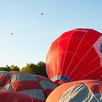 Participants prepare for takeoff during the Velence Lake International Hot Air Balloon Festival in Agard, Slovakia on September 10, 2011. ATTILA VOLGYI