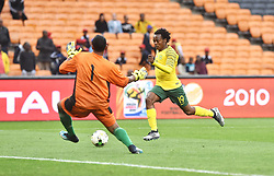 South Africa: Johannesburg: Bafana Bafana player Percy Tau challenges for the ball with Seychelles goalkeeper Romeo Barra during the Africa Cup Of Nations qualifiers at FNB stadium, Gauteng.<br />Picture: Itumeleng English/African News Agency (ANA)
