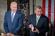Vice President Joe Biden looks on as Speak of the House, John Boehner shows off his handkerchief that he as in case he sheds tears during Pope Francis' speech to a joint meeting of Congress at the U.S. Capitol in Washington, District of Columbia, U.S., on Thursday, Sept. 24, 2015. The Pope is calling for Americans to do more to fight poverty, curb climate change and help immigrants. His visit runs through Sept. 27, and features stops in Washington, New York and Philadelphia.