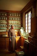 Monk inside the Pharmacy of Il Redentor on Giudecca Island. Venice, Italy, Europe